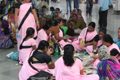 The Gulabi Gang: Waiting for a Train in Mumbai, India